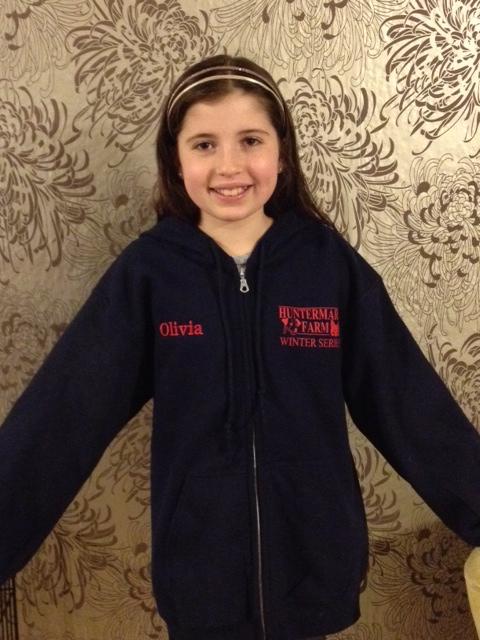 Olivia Overton models the hooded sweatshirt