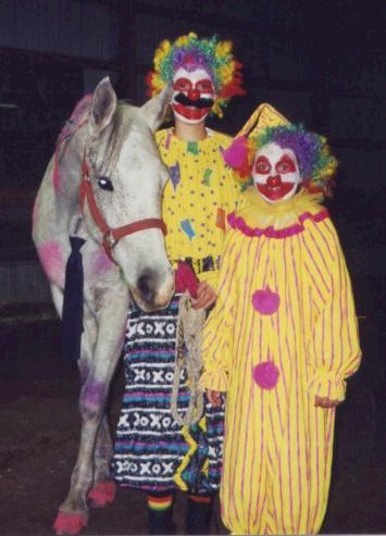 Allie and Gabrielle Armetta clowing around with their horse at the fun show, 2004
