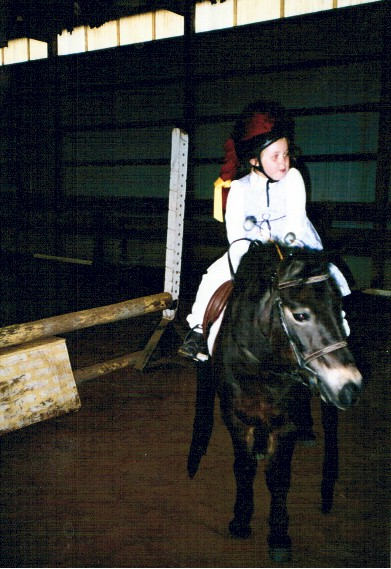 Cathryn Bridges as Little Miss Muffet, not on her tuffet, but on her pony Baxter as the spider that sat down beside her, 2002