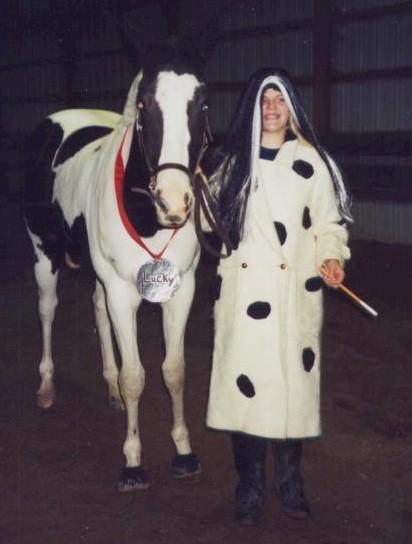 Ellen Reeder as Cruella DeVille with her horse (dalmation) Lucky, 2004