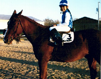 "Joanna Hagen as a jockey on Monica Beers' racehorse ""Gold Rush"", 1999"
