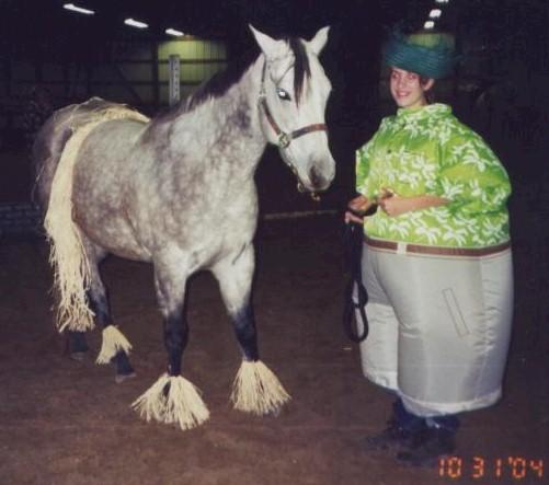 Jody Wellman as a fat Hawaiian with Holly the hula girl, 2004