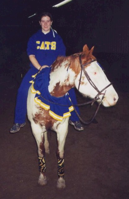 Katie Homrighausen and her horse L'eggs are cheerleaders, 2004