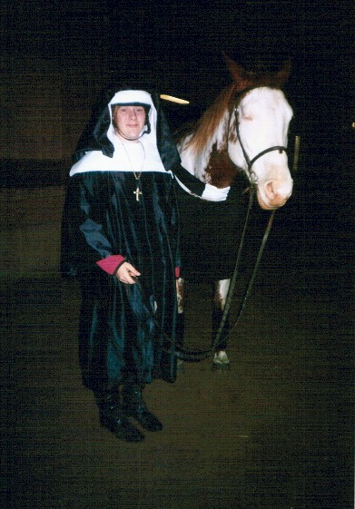 Katie Homrighausen as a nun with her horse Leggs as a priest, 2003