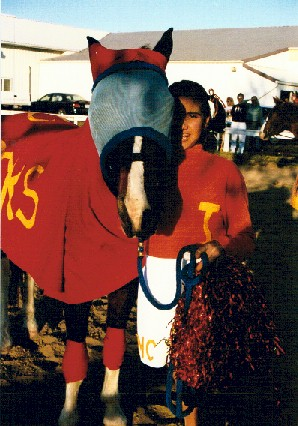 Molly Cordero as a cheerleader with her pony Joey as a football player, 1999