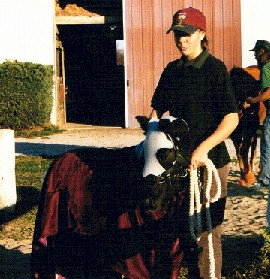 Monica is holding her miniature Patrick, a knight's horse, 1999