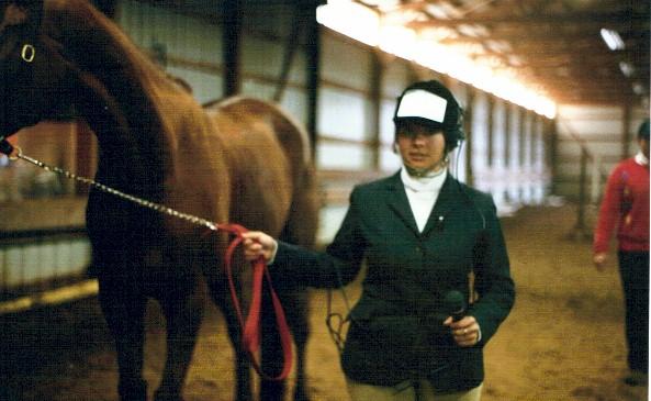 Rachel Rock as a reporter for HTV news interviews Cadillac, 2002