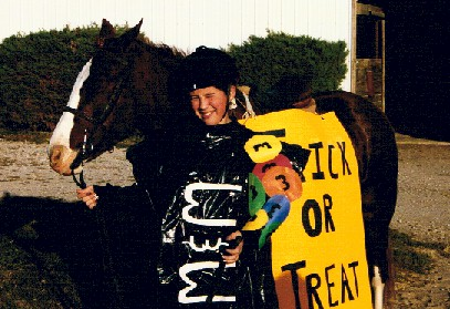Rebecca Ickes as a bag of M&Ms with Bitsy as the trick or treat bag, 1999