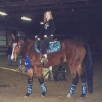 Ivy is a knight's horse and Sara VanIseghem is a person riding a knight's horse, 2004