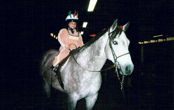Tori McCaw as an indian princess, with Holly as an indian pony, 2003