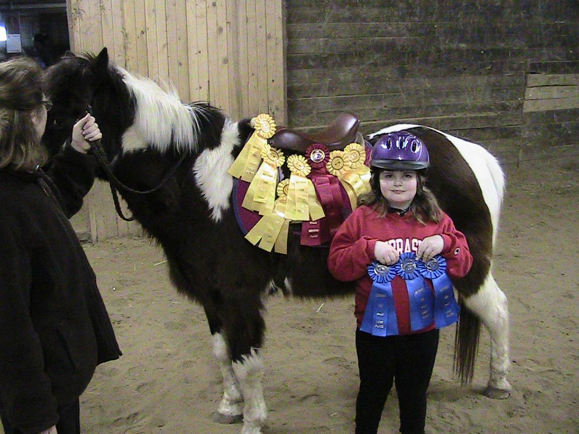 Ashlyn shows off all of her ribbons from showing Joey in April 2009