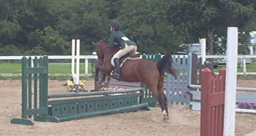 Sara VanIseghem and her pony Midnight Rengade competing in a MIHJA recognized show