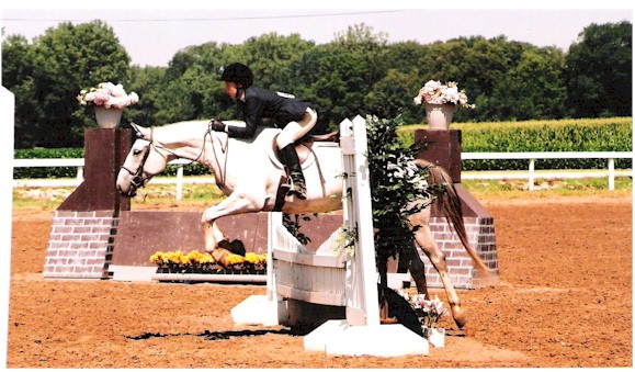 He isn't dropping his knees, he's landing.  But check out Sara's eq!