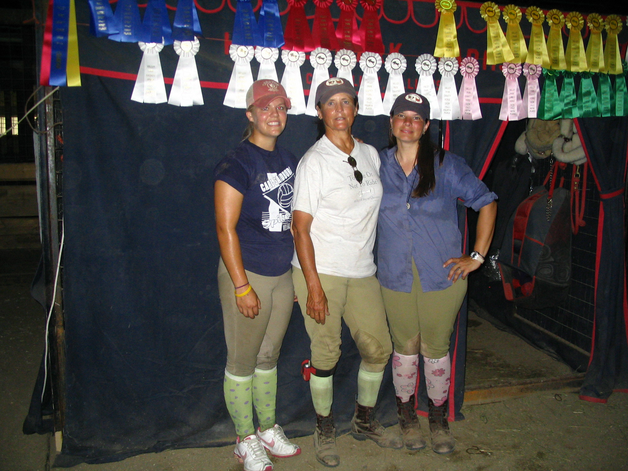 Show team minus Joanna and her ribbons won on her horse Rock Opera